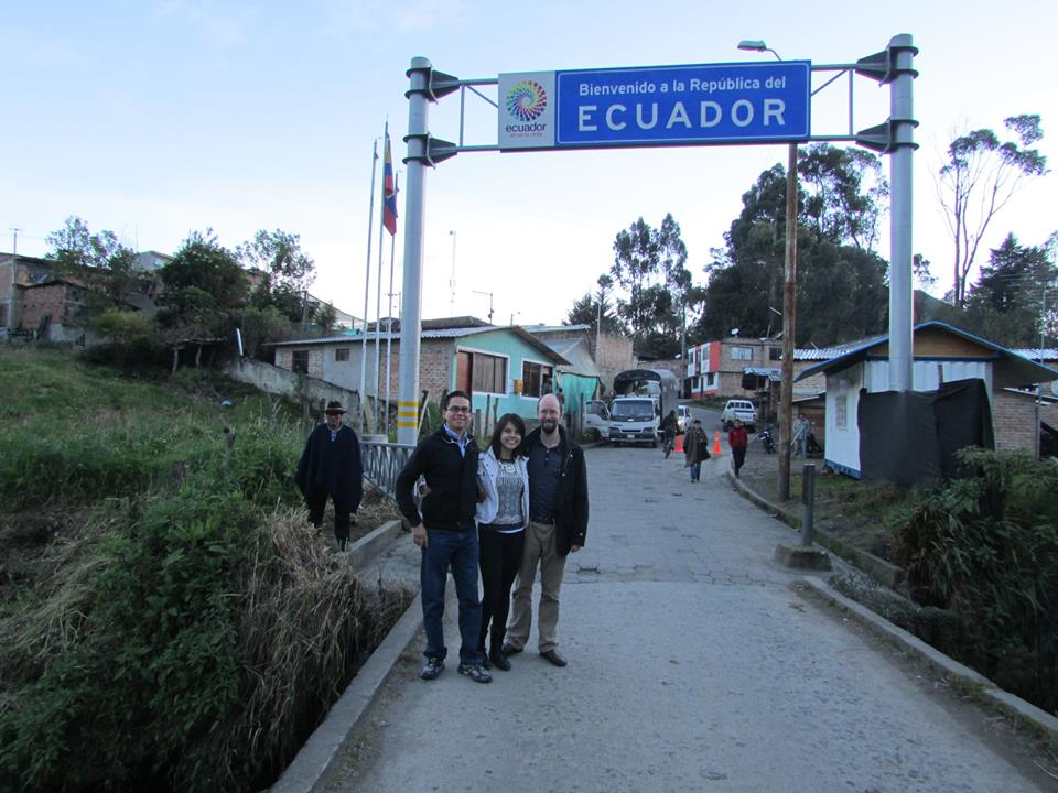 Research team on bridge bordering Ecuador and Colombia